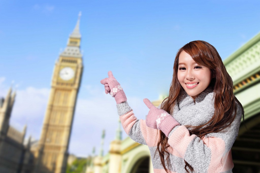 Happy woman travel in london with Big Ben in United Kingdom, uk